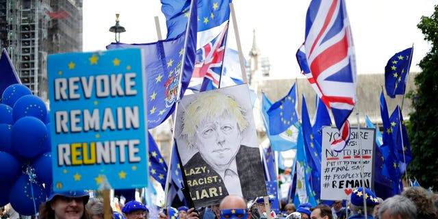 Pro-EU supporters protest outside the Houses of Parliament in London, Tuesday, Sept. 3, 2019.