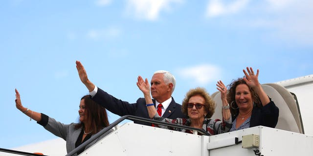 Vice President Pence and members of his family wave goodbye as they board the Dublin Air Force on Tuesday. (AP Photo / Peter Morrison)