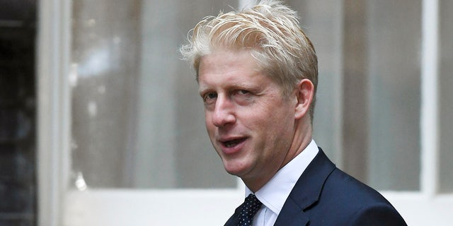 """FILE - In this Wednesday, Sept. 4, 2019 file photo, Britain's Conservative Party lawmaker Jo Johnson arrives at Downing Street in London. Jo Johnson has announced he is quitting as an education minister and will step down from Parliament, saying he is """"torn between family loyalty and the national interest."""" (AP Photo/Alberto Pezzali, File)"""