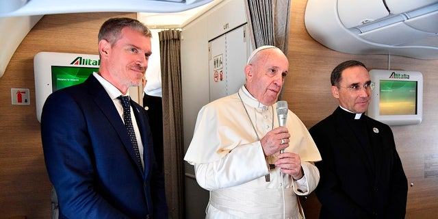 Pope Francis with his spokesperson Matteo Bruni, left, addressing journalists during his flight from Rome to Maputo, Mozambique, on Wednesday. (Sandro Perusini/Pool photo via AP)