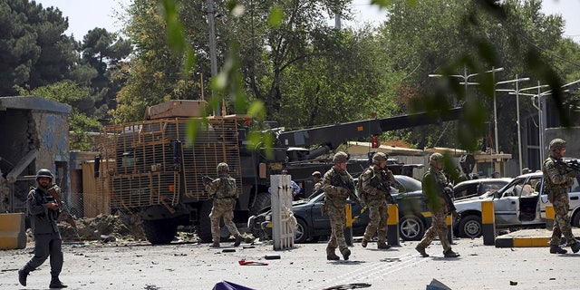 British soldiers arrive at the site of a car bomb explosion in Kabul, Afghanistan, Thursday, Sept. 5, 2019. A car bomb rocked the Afghan capital on Thursday and smoke rose from a part of eastern Kabul near a neighborhood housing the U.S. Embassy, the NATO Resolute Support mission and other diplomatic missions. (AP Photo/Rahmat Gul)