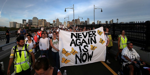 """Never Again Is Now"" protesters rally at the New England Holocaust Memorial and then march across the Longfellow bridge into the Amazon local business building lobby, Thursday, Sept. 5, 2019 in Cambridge, Mass. (Associated Press)"