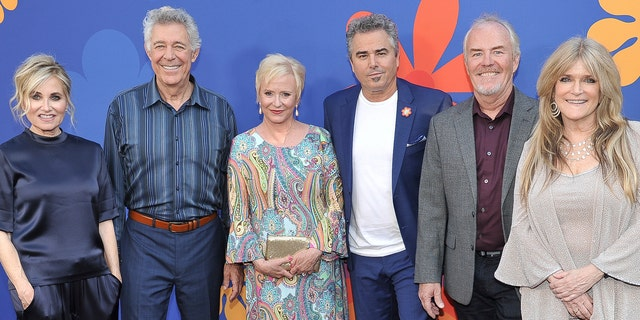 "From left to right: Maureen McCormick, Barry Williams, Eve Plumb, Christopher Knight, Mike Lookinland and Susan Olsen at the premiere of ""A Very Brady Renovation"" in 2019. (Photo by Richard Shotwell/Invision/AP)"