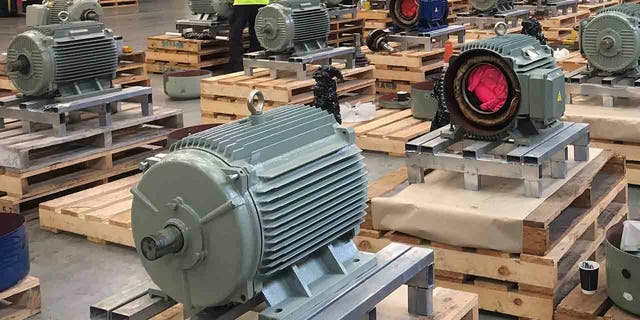 In this Aug. 26, 2019 photo provided by New Zealand Customs, shows electric motors found in a container from Thailand with 469 kilograms of methamphetamine concealed in the motors. Police said Friday, Sept. 6, 2019, the US$153 million worth of the drug is the largest ever seizure at New Zealand's border. (New Zealand Customs via AP)