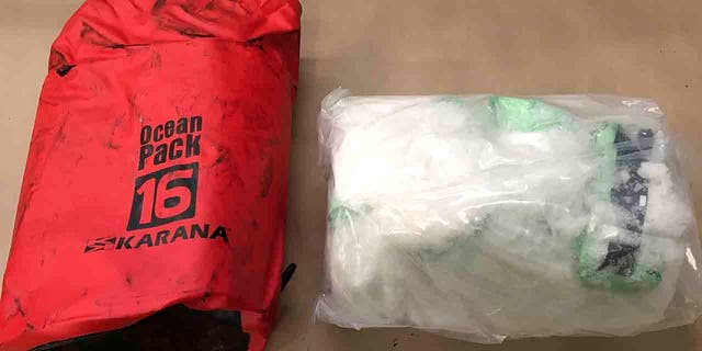 In this Aug. 26, 2019 photo provided by New Zealand Customs, shows a bag of methamphetamine found in a container from Thailand with 469 kilograms of methamphetamine concealed in electric motors. Police said Friday, Sept. 6, 2019, the US$153 million worth of the drug is the largest ever seizure at New Zealand's border. (New Zealand Customs via AP)
