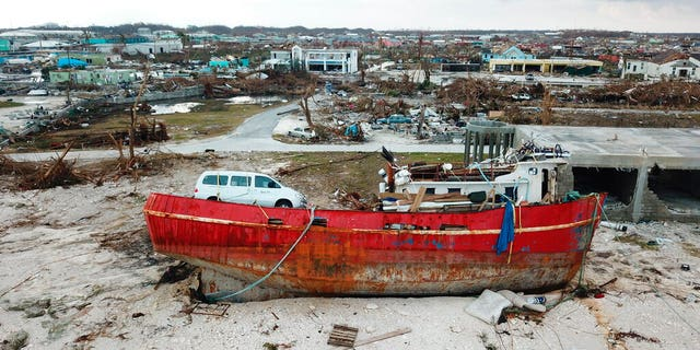 A boat sits grounded in the aftermath of Hurricane Dorian, in Marsh Harbor, Abaco Island, Bahamas, Friday, Sept. 6, 2019.