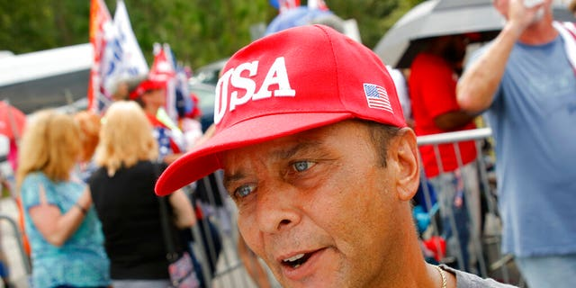 Dilber Jimenez from Raleigh, N.C., talks about why he supports President Donald Trump before a campaign rally in Fayetteville, N.C., Monday Sept. 9, 2019 (AP Photo/Chris Seward)