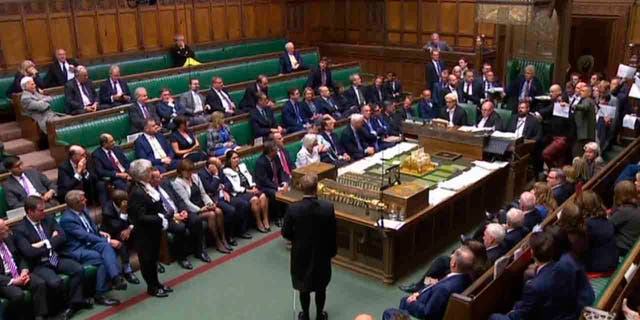 In this image made from video, British lawmakers stage a protest in the House of Commons, in London, Sept. 10, 2019. (Parliament TV via PA via AP)