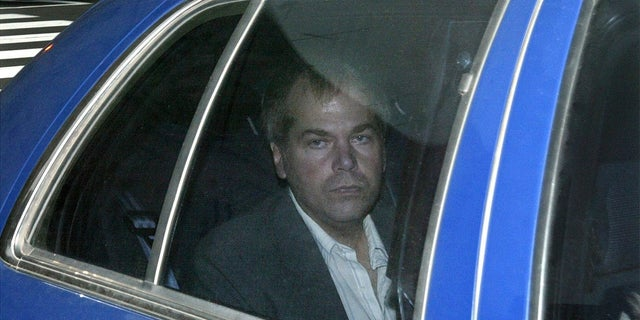 John Hinckley Jr. arrives at U.S. District Court in Washington in 2003. (AP Photo/Evan Vucci, File)