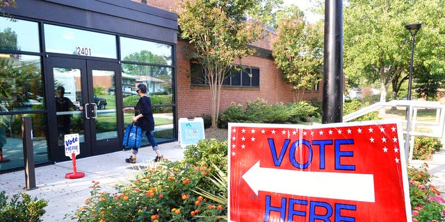 A voter enters a precinct at the West Charlotte Recreation Center Tuesday. (John D. Simmons/The Charlotte Observer via AP)