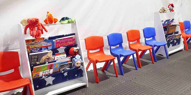 Stuff animals, story books and small chairs fill the Juvenile waiting area at the Migrant Protection Protocols Immigration Hearing Facilities in Laredo, Tuesday, Sept. 10, 2019. (Ricardo Santos/The Laredo Morning Times via AP)