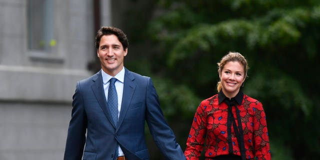 Prime Minister Justin Trudeau and Sophie Gregoire Trudeau arrive at Rideau Hall in Ottawa, Wednesday, Sept.11, 2019. (Justin Tang/The Canadian Press via AP)