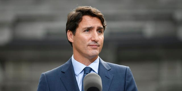Liberal leader Justin Trudeau talks to media at Rideau Hall in Ottawa, Wednesday, Sept.11, 2019. Trudeau emerged from Rideau Hall after visiting the Governor General and asking her to dissolve Parliament to begin the formal federal election campaign. (Justin Tang/The Canadian Press via AP)