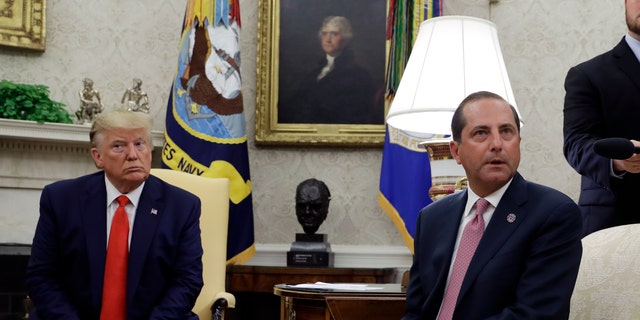 President Trump and Health and Human Services Secretary Alex Azar talk to the media in the Oval Office, Wednesday, Sept. 11, 2019, at the White House in Washington.  (AP Photo/Evan Vucci)