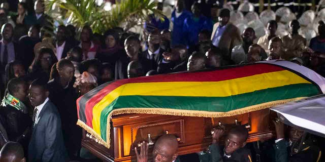 The body of former president Robert Mugabe arrives to lie in state inside his official residence in the capital Harare Zimbabwe Wednesday Sept. 11 2019
