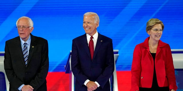From left, presidential candidates Sen. Bernie Sanders, I-Vt., former Vice President Joe Biden and Sen. Elizabeth Warren, D-Mass., are introduced Thursday, Sept. 12, 2019, before a Democratic presidential primary debate hosted by ABC at Texas Southern University in Houston. (Associated Press)