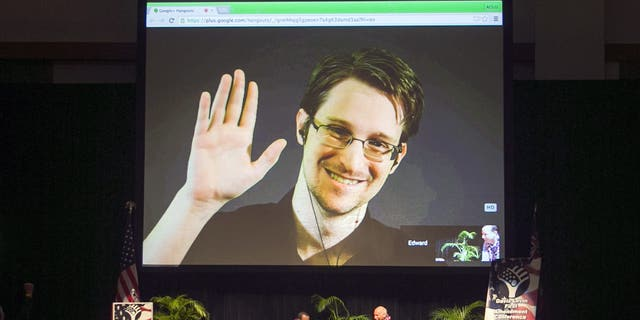 Edward Snowden appears on a live video feed broadcast from Moscow at an event sponsored by ACLU Hawaii in Honolulu, on Feb. 14, 2015. (AP Photo/Marco Garcia, File)