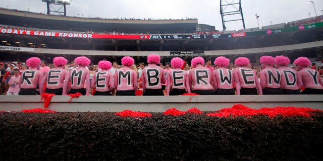 Westlake Legal Group AP19257662431430 Opposing Georgia fans honor wife of coach who died of breast cancer with 'pink out' fox-news/us/us-regions/southeast/georgia fox-news/us/us-regions/midwest/arkansas fox-news/health/cancer/breast-cancer fox news fnc/sports fnc David Aaro article 84f26350-843e-55b5-b7b3-d161b956532e