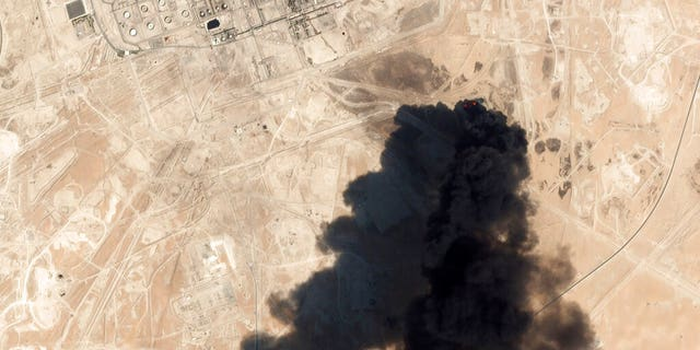 This Saturday satellite image showed thick black smoke rising from Saudi Aramco's Abqaiq oil processing facility in Buqyaq, Saudi Arabia.