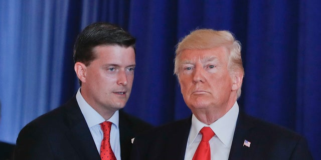In this Aug. 12, 2017, photo, Rob Porter, left, White House staff secretary, speaks to President Trump after Trump made remarks regarding the ongoing situation in Charlottesville, Va., at Trump National Golf Club in Bedminister, N.J. (AP Photo/Pablo Martinez Monsivais)<br>