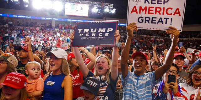Supporters of President Donald Trump cheer as he arrives to speak at a campaign rally at the Santa Ana Star Center, Monday, Sept. 16, 2019, in Rio Rancho, N.M. (AP Photo/Evan Vucci)
