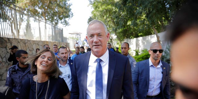Blue and White party leader Benny Gantz and his wife Revital leave a polling station in Rosh Haayin, Israel, on Sept. 17, 2019.
