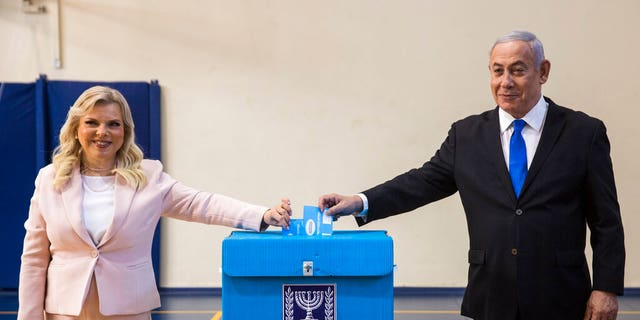 Israeli Prime Minister Benjamin and his wife Sarah cast their votes at a voting station in Jerusalem on Sept. 17, 2019.