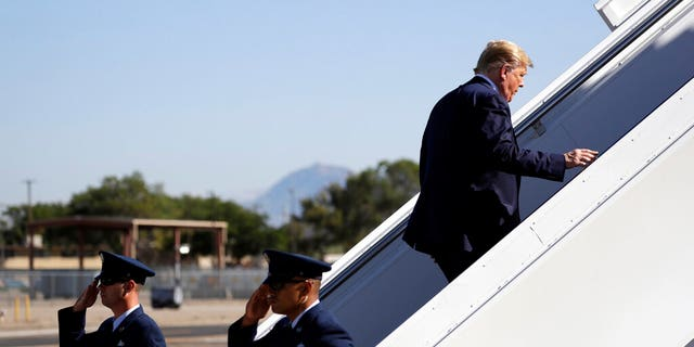 President Donald Trump boarding Air Force One in Albuquerque on his way to California on Tuesday. (AP Photo/Evan Vucci)