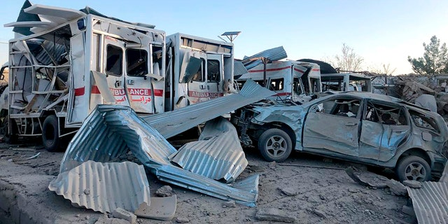 Damaged cars are seen at the site of a suicide attack in Zabul, Afghanistan, Thursday, Sept. 19, 2019. A powerful early morning suicide truck bomb devastated a hospital in southern Afghanistan on Thursday. (AP Photo/Ahmad Wali Sarhadi)
