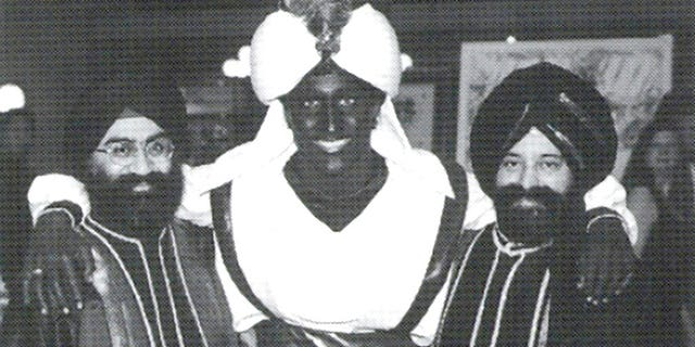 "This April 2001 photo, which appeared in a newsletter from the West Point Grey Academy, showed a costumed Justin Trudeau, his face and hands darkened by makeup, attending the ""Arabian Nights"" gala."
