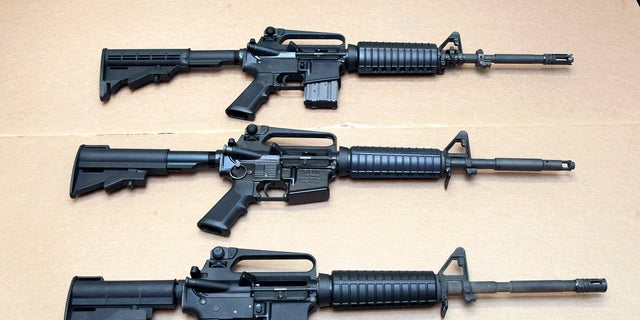 In this Aug. 15, 2012, photo, three variations of the AR-15 rifle are displayed at the California Department of Justice in Sacramento, Calif. (AP Photo/Rich Pedroncelli, File)
