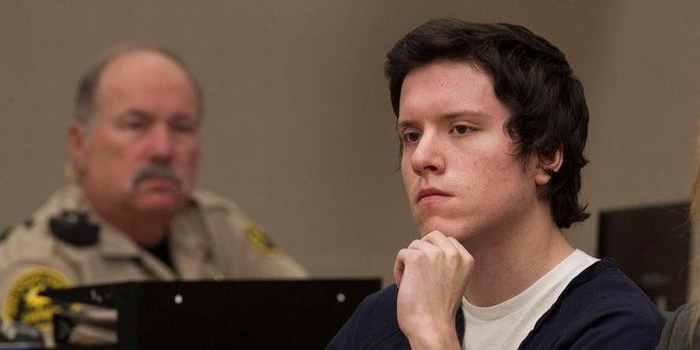 Defendant John Earnest listens during testimony by witness Oscar Stewart during Earnest's preliminary hearing on Thursday in San Diego. (John Gibbins/The San Diego Union-Tribune via AP, Pool)