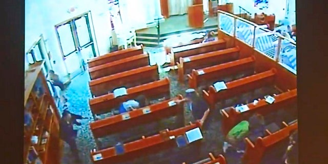 This April 27 photo from surveillance video at the Chabad of Poway shows people diving for cover as a shooting unfolds. (Chabad of Poway/San Diego Superior Court via AP)
