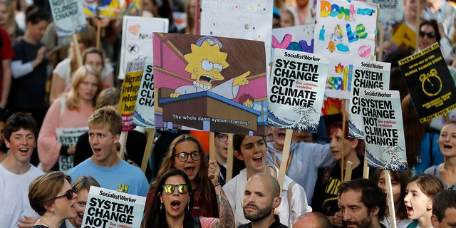 Climate protesters demonstrate in London, Friday, Sept. 20, 2019. Protesters around the world joined rallies on Friday as a day of worldwide demonstrations calling for action against climate change began ahead of a U.N. summit in New York.
