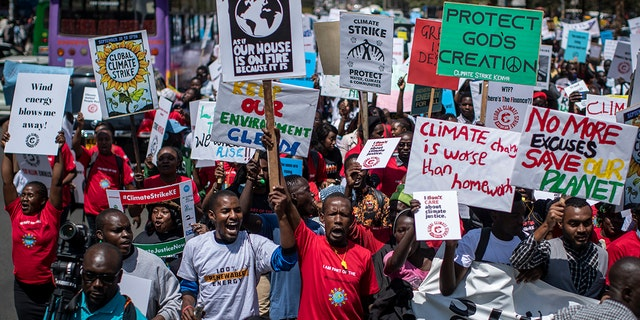 Around a thousand protesters march to demand action on climate change, in the streets of downtown Nairobi, Kenya Friday, Sept. 20, 2019. Protesters around the world joined rallies on Friday as a day of worldwide demonstrations calling for action against climate change began ahead of a U.N. summit in New York.