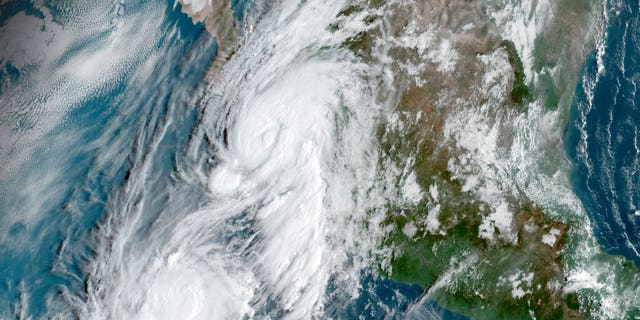 This GOES-16, GeoColor satellite image taken Friday, Sept. 20, 2019, at 14:50 UTC and provided by National Oceanic and Atmospheric Administration (NOAA), shows Hurricane Lorena, top center, followed by Tropical Storm Mario, near the southern tip of Mexico's Baja California peninsula.