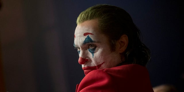 "This image released by Warner Bros. Pictures shows Joaquin Phoenix in a scene from ""Joker,"" in theaters on Oct. 4. The Army is warning soldiers about the potential for violence at screenings of the film."
