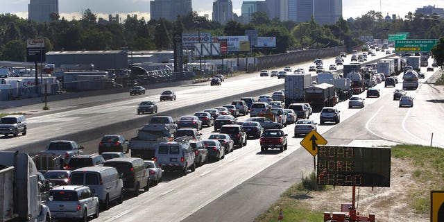 FILE: Drivers enter Sacramento on Highway 50 to come to a near stand still as traffic backs up in West Sacramento, Calif.