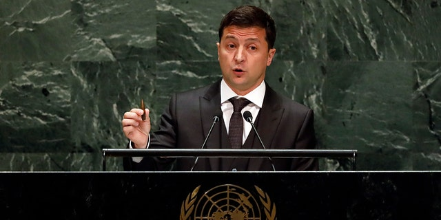 Ukraine's President Volodymyr Zelensky holds a bullet as he addresses the 74th session of the United Nations General Assembly, Wednesday, Sept. 25, 2019.