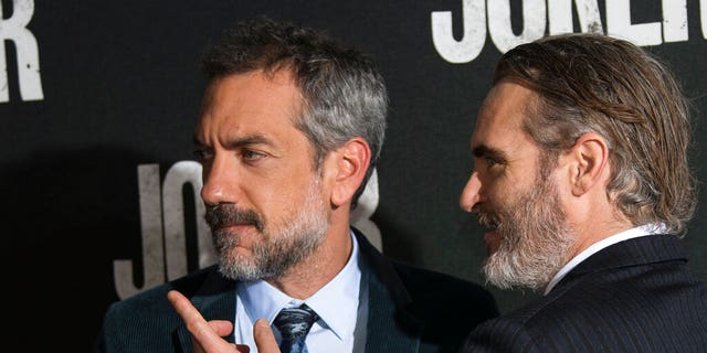 """Joker"" director Todd Phillips, left, and actor Joaquin Phoenix at the screening for the movie at a central London cinema on Wednesday, Sept. 25. (Photo by Joel C Ryan/Invision/AP)"