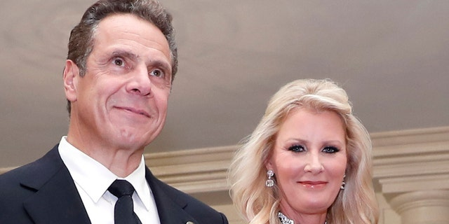FILE- In this Oct. 18, 2016 file photo, Gov. Andrew Cuomo, D-N.Y., is accompanied by his girlfriend Sandra Lee as they arrive for a state dinner at the White House in Washington. The couple announced on Wednesday, Sept. 25, 2019 that they have broken up after more than a decade together. (AP Photo/Alex Brandon, File)