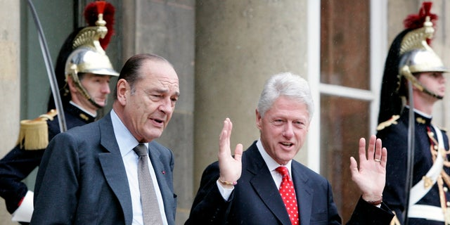 In this June 6, 2005 file photo, former French President Jacques Chirac, left, and former U.S. president Bill Clinton leave after their meeting at the Elysee Palace in Paris. (AP Photo/Jacques Brinon, File)