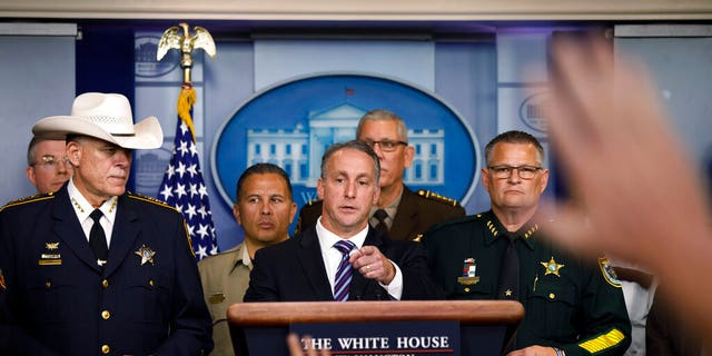 Acting Director of U.S. Immigration and Customs Enforcement Matthew Albence, joined by members of law enforcement, speaks during a news conference at the White House in Washington, Thursday, Sept. 26, 2019. (AP Photo/Carolyn Kaster)