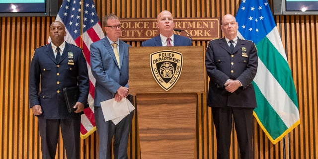 New York City Police Commissioner James O'Neill, center, and others at a news conference on Monday about the death. (AP Photo/Mary Altaffer)