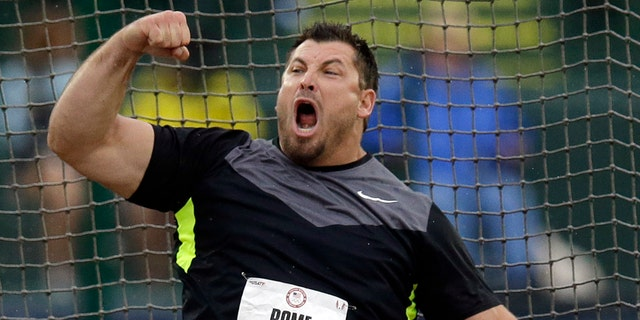 Jarred Rome celebrates his second-place finish in the men's discus final at the U.S. Olympic Track and Field Trials Thursday, June 28, 2012, in Eugene, Ore. (AP Photo/Charlie Riedel)
