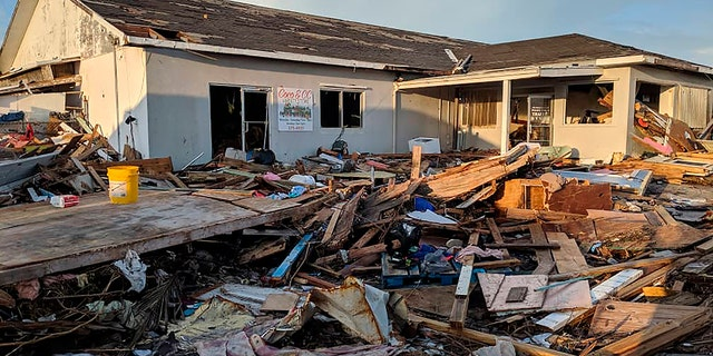 Debris blankets the landscape in the aftermath of Hurricane Dorian in Marsh Harbor, Abaco, Bahamas, Thursday, The storm's devastation has come into sharper focus as the death toll climbed to 20 and many people emerged from shelters to check on their homes.