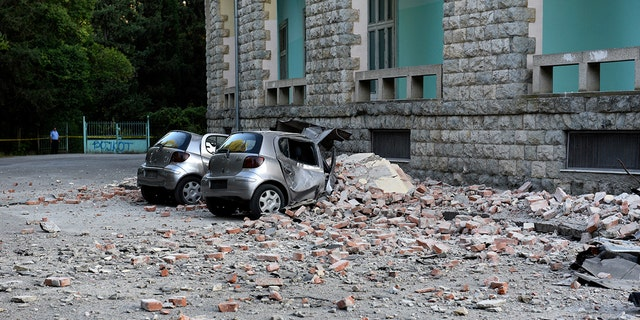 Flattened cars were parked outside the Faculty of Geology building in Tirana. (AP Photo/Hektor Pustina)