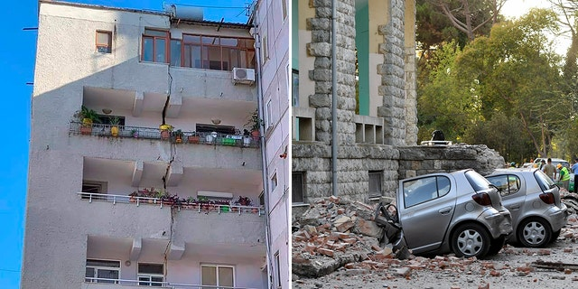 Buildings suffered cracks and cars were crushed underneath falling bricks.