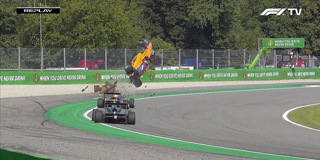 The vehicle of Alex Peroni, 19, was launched into the air after he hit a curb during a race in Monza, Italy. He suffered a fractured vertebra.
