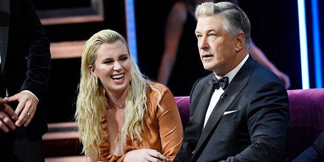 Ireland Baldwin (left) defended her father Alec Baldwin's (right) wife Hilaria Baldwin last month amid a controversy surrounding her Spanish heritage.